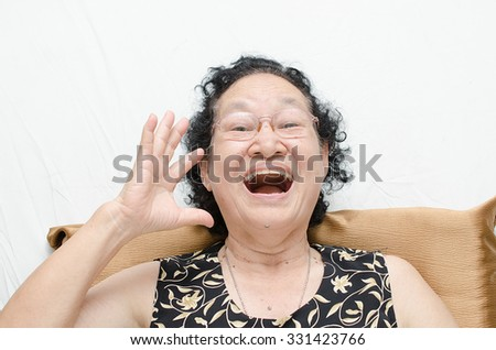 Portrait of asian senior woman glad expression