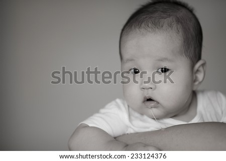 Portrait of asian toddler in mother hug