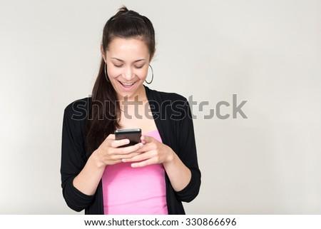 Portrait of Asian woman using phone - stock photo