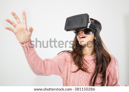 portrait of asian woman wearing virtual reality goggle - stock photo