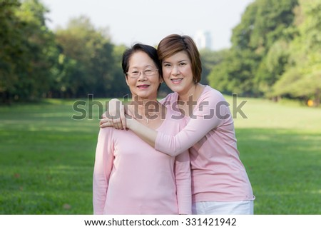 Portrait of Asian women in the park - stock photo