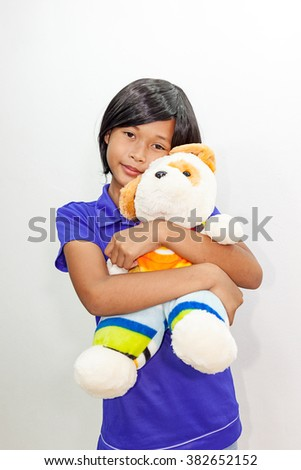 Portrait of asian young Girl with doll.