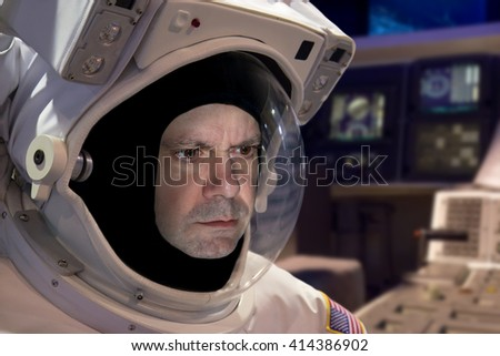 Portrait of astronaut in helmet on board the spaceship. Adventurous journey in universe. Cosmonaut in space suit work on the space station. Space research.