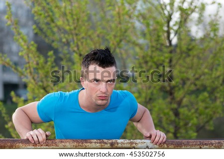 Portrait Of Athletic Man With Fit Muscular Body Resting After Jogging
