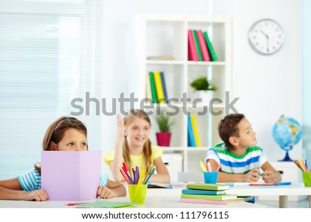 Portrait of attentive children listening to the teacher at lesson