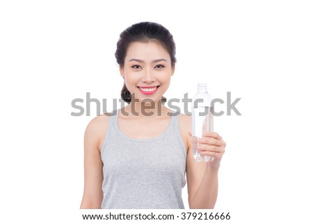 Portrait of attractive asian smiling woman isolated on white studio shot drinking water - stock photo