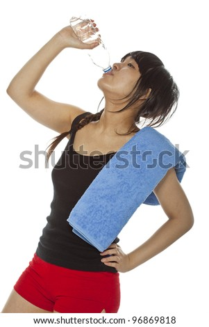 Portrait of attractive Asian woman drinking mineral water from bottle  after fitness class. Isolated on white, studio shot, closeup