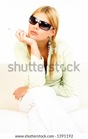 Portrait of attractive beautiful young woman with black sunglasses and cigarette