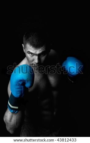 Portrait of attractive boxer in the dark - stock photo