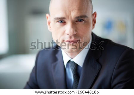 Portrait of attractive businessman looking at camera - stock photo