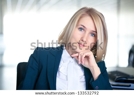 Portrait of attractive businesswoman in the workplace - stock photo