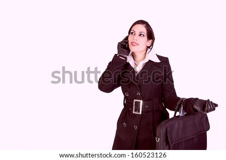 portrait of attractive businesswoman talking on cell phone