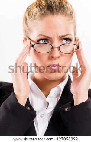 Portrait of attractive businesswoman with glasses. She is worried.