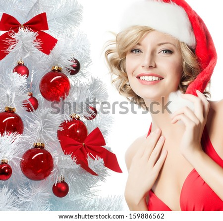 portrait of attractive  caucasian smiling woman blond isolated on white studio shot in santa's hat and red dress - stock photo