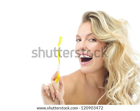 portrait of attractive  caucasian smiling woman blond isolated on white studio shot  toothy smile face long hair head and shoulders looking at camera brushing her teeth - stock photo