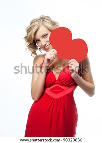 portrait of attractive  caucasian smiling woman blond isolated on white studio shot with heart - stock photo