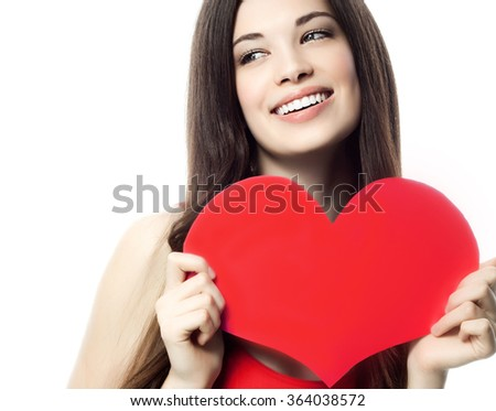 portrait of attractive  caucasian smiling woman brunette isolated on white studio shot with heart - stock photo