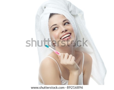 portrait of attractive  caucasian smiling woman isolated on white studio shot brushing her teeth - stock photo