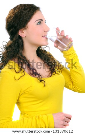 portrait of attractive caucasian smiling woman isolated on white studio shot drinking water