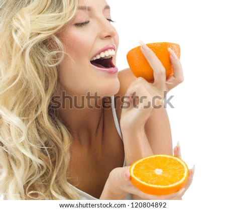portrait of attractive  caucasian smiling woman isolated on white studio shot eating orange - stock photo