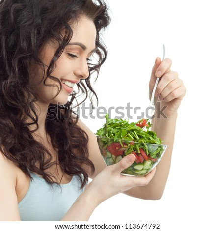 portrait of attractive  caucasian smiling woman isolated on white studio shot eating salat salad - stock photo