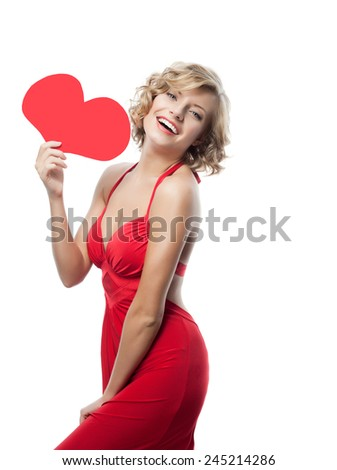 portrait of attractive  caucasian smiling woman isolated on white studio shot with heart in red dress - stock photo