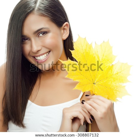 portrait of attractive  caucasian smiling woman isolated on white studio shot with yellow autumn leaf - stock photo
