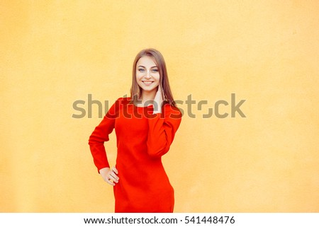 Portrait of attractive caucasian smiling woman isolated on yellow wall background. studio shot, horizontal image