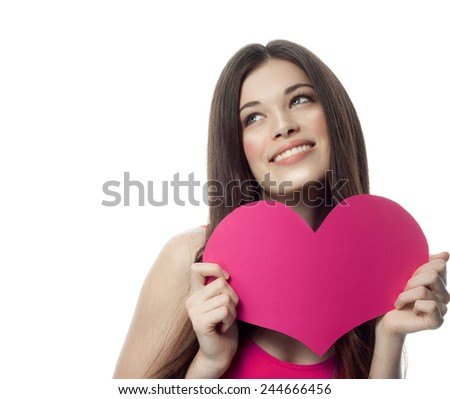 portrait of attractive  caucasian smiling young woman blond isolated on white studio shot with heart