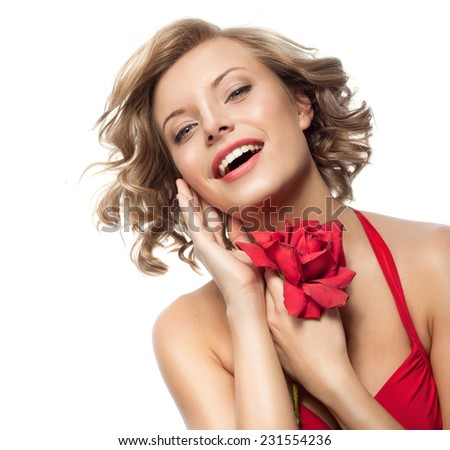 portrait of attractive  caucasian smiling young woman blond isolated on white studio shot with red  rose flower - stock photo