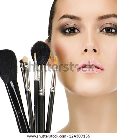 portrait of attractive  caucasian  woman brunette isolated on white studio shot closeup makeup brushes - stock photo