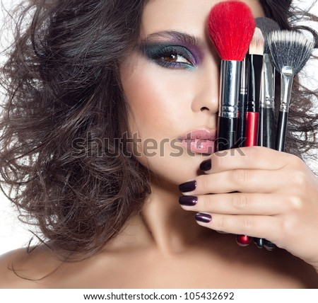 portrait of attractive  caucasian woman brunette isolated on white studio shot face closeup brushes skin makeup eyes hands nails - stock photo
