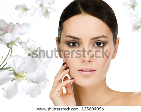 portrait of attractive  caucasian  woman brunette isolated on white studio shot face closeup skin eyes looking at camera flowers - stock photo