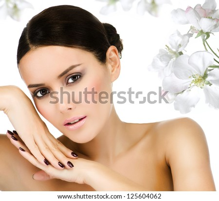 portrait of attractive  caucasian  woman brunette isolated on white studio shot flowers - stock photo