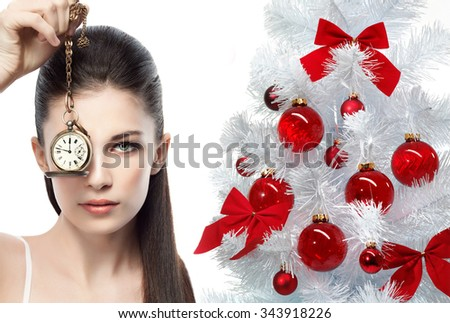 portrait of attractive  caucasian woman brunette isolated on white studio shot with watch time christmas tree new year - stock photo