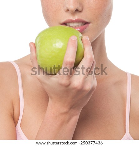 portrait of attractive caucasian woman isolated on white studio shot eating green apple - stock photo