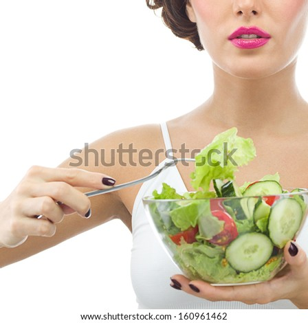 portrait of attractive  caucasian woman isolated on white studio shot eating salat - stock photo