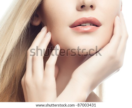 portrait of attractive  caucasian woman  with long blond hair isolated on white studio shot hands near face - stock photo