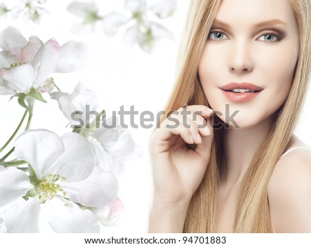 portrait of attractive  caucasian woman  with long blond hair isolated on white studio shot looking at camera - stock photo