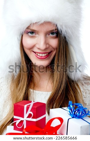 Portrait of attractive cheerful girl holding gift boxes - stock photo