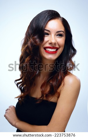 Portrait of attractive cheerful woman looking away - stock photo