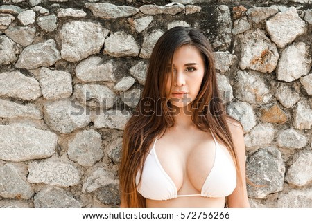 stone asian portrait attractive confident young sexy asian stock photo