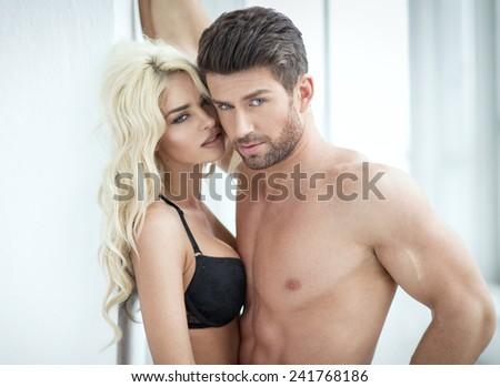 Portrait of attractive couple - stock photo