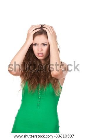 portrait of attractive depressed teenage girl hold hands on head, green shirt, brown long hair, isolated over white background concept of sad young pretty woman, problem worried hopeless student - stock photo