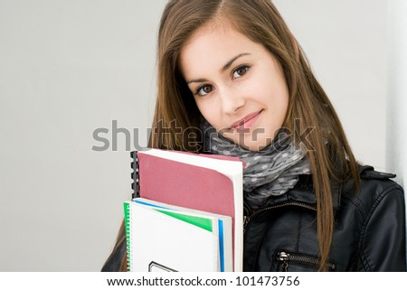 Portrait of attractive fresh young brunette student girl. - stock photo