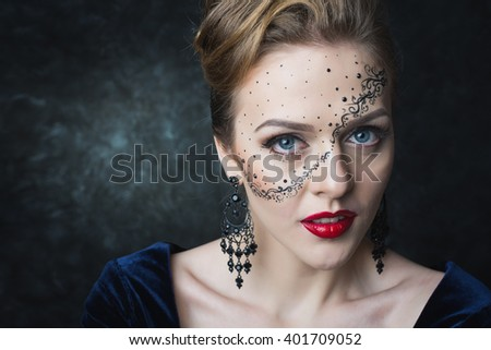 Portrait of attractive girl with art makeup posing on a dark background in the studio. Different emotions and poses. Quality Face Retouch. The huge size of the image. - stock photo