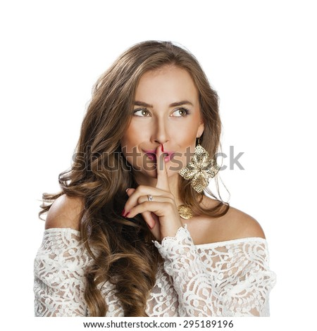 Portrait of attractive girl with finger on lips, isolated over white background concept of student show quiet, silence, secret gesture, young pretty brunette woman - stock photo