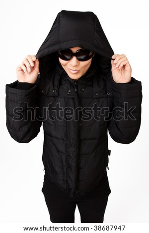 Portrait of attractive girl with sunglasses wearing coat
