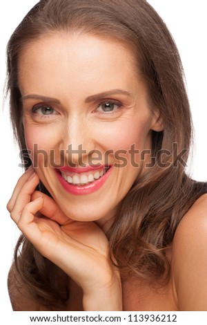 Portrait of attractive groomed healthy middle-aged woman touching her face on white background