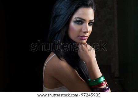 portrait of attractive indian female fashion model - stock photo